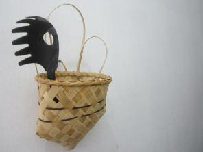 "Revived Caddy - set of three. The basket design was taken from the old catalogue of the Nabua Home Industries Center and it was given a bit of a twist. The new (""kitchen"") caddy now features an ear handle convenient for hanging the basket, and some simple striped designs using abaca (Manila hemp). Personally, I think this caddy would be useful in taming our unruly cables and other portables. ;) Materials: Banban (bamboo strips), Abaca (Manila Hemp), Uwoy (I don't know the English word for this yet but it's a local grass), glue, varnish"